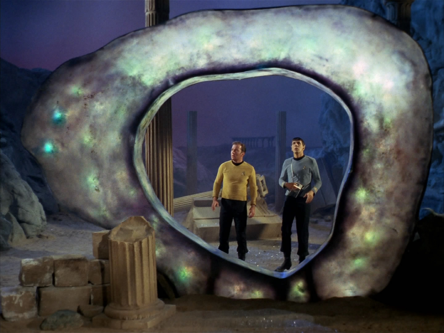 Kirk and Spock staring in awe at an ancient glowing alien artifact.